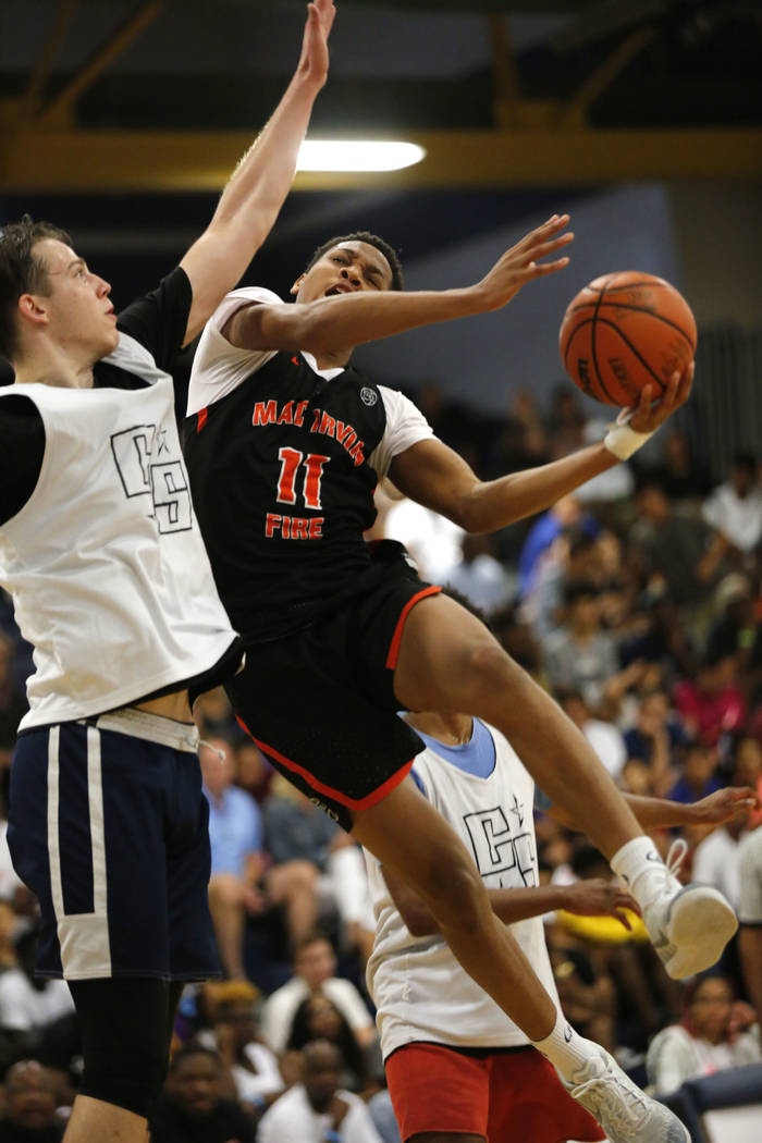 Mac Irvin Fire's Terrence Shannon Jr. (11) shoots over California Stars' Lazar Nekic, left, during the second half of the Las Vegas Classic platinum premier championship game at Spring Valley High ...