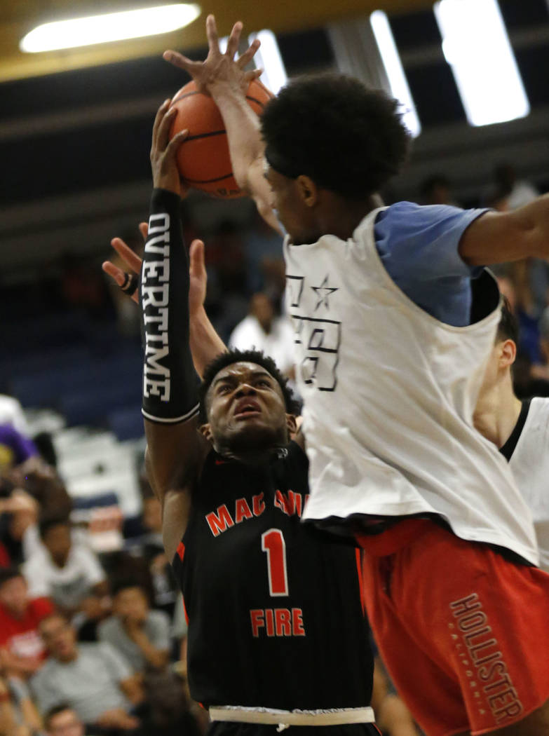 Mac Irvin Fire's Markese Jacobs (1) tries to shoot over California Stars' Jordan Brinson, right, during the second half of the Las Vegas Classic platinum premier championship game at Spring Valley ...