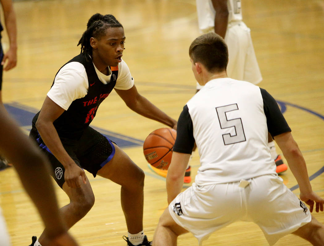 The Truth's Earvin Knox (11) prepares to dribble past DC Premier's Evan Buckley (5) at the Fab 48 tournament at Bishop Gorman High School in Las Vegas, Sunday, July 29, 2018. Rachel Aston Las Vega ...