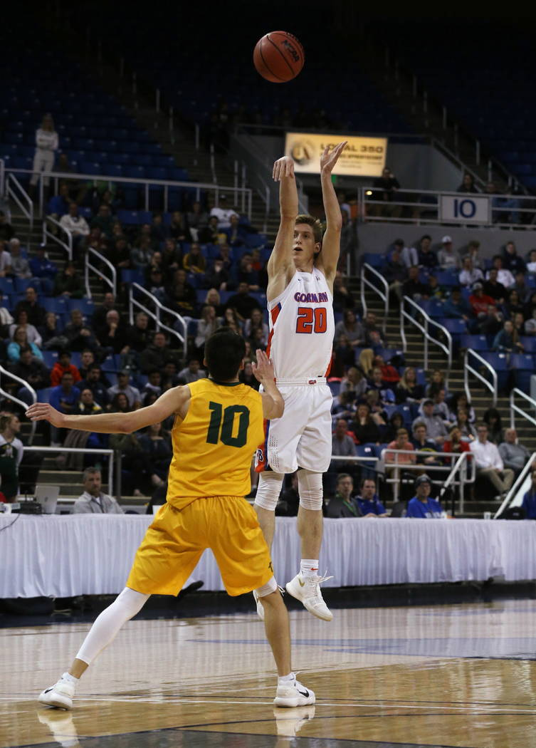 Bishop Gorman's Noah Taitz shoots over Bishop Manogue defender Kolton Frugoli during the 4A NIAA state basketball championship game in Reno, Nev., on Friday, Feb. 23, 2018. Gorman won 62-41. Cathl ...