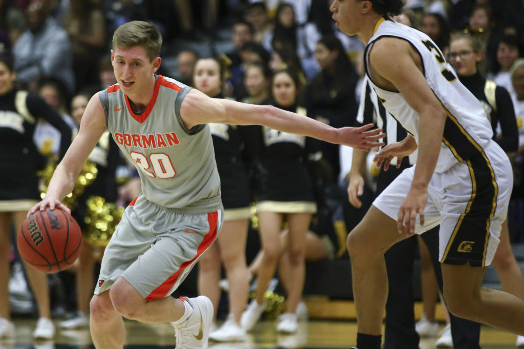 Bishop Gorman's Noah Taitz (20) drives past Clark's Ian Alexander (32) during a basketball game at Clark High School in Las Vegas on Tuesday, Jan. 30, 2018. Chase Stevens Las Vegas Review-Journal ...