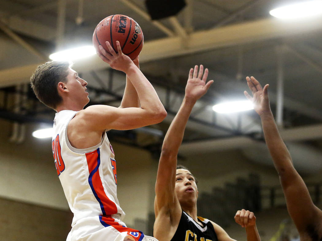 Bishop Gorman's Noah Taitz (20) shoots against Clark's Ian Alexander (32) during the Sunset Region boys basketball championship at Legacy High School in North Las Vegas on Saturday, Feb. 17, 2018 ...