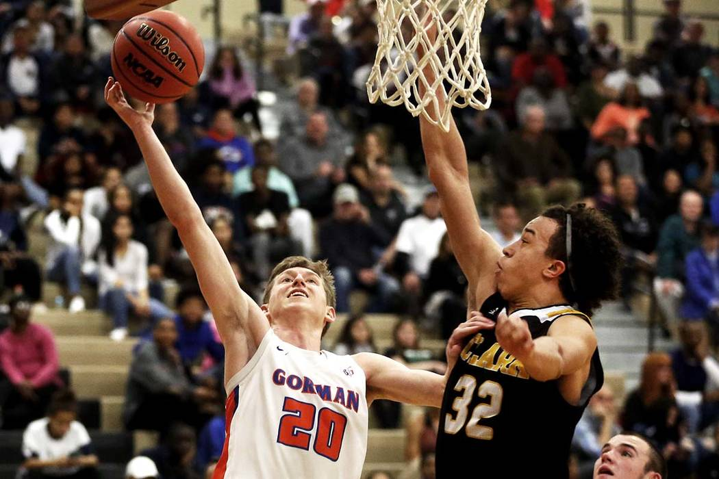 Bishop Gorman's Noah Taitz (20) shoots against Clark's Ian Alexander (32) during the Sunset Region boys basketball championship at Legacy High School in North Las Vegas on Saturday, Feb. 17, 2018. ...