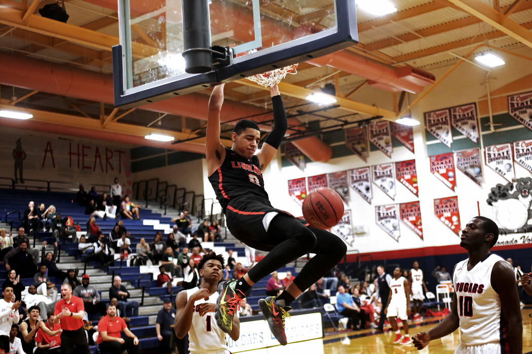 Liberty High School's Julian Strawther (0) slam dunks in a game against Coronado High School at Coronado High School in Henderson, Wednesday, Feb. 7, 2018. Liberty won 69-61. Rachel Aston Las Vega ...