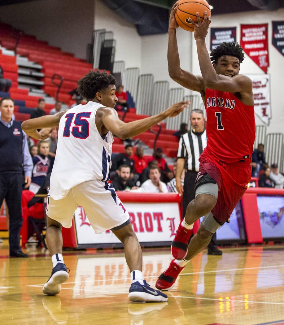 Coronado's Jaden Hardy (1) dribbles around Liberty's Cameron Burist (15) at Liberty High School on Tuesday, Jan. 23, 2018. Liberty won 98-87. Patrick Connolly Las Vegas Review-Journal @PConnPie