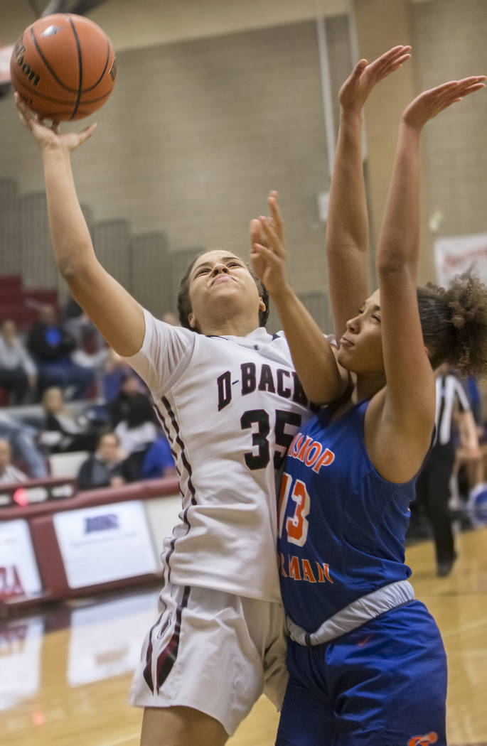Desert Oasis' Dajaah Lightfoot (35) shoots over Bishop Gorman's Georgia Ohiaeri (13) during the Diamondbacks home matchup with the Gaels on Tuesday, Jan. 10, 2017, at Desert Oasis High School, in ...