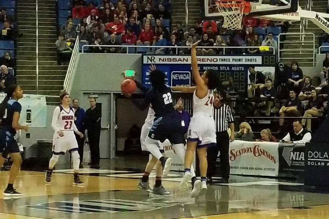 Eboni Walker drives the lane against Reno on Thursday, Feb. 22, 2018 at Lawlor Events Center in Reno. Centennial beat Reno High 68-30 in the Class 4A state semifinals. (Damon Seiters/Las Vegas Rev ...