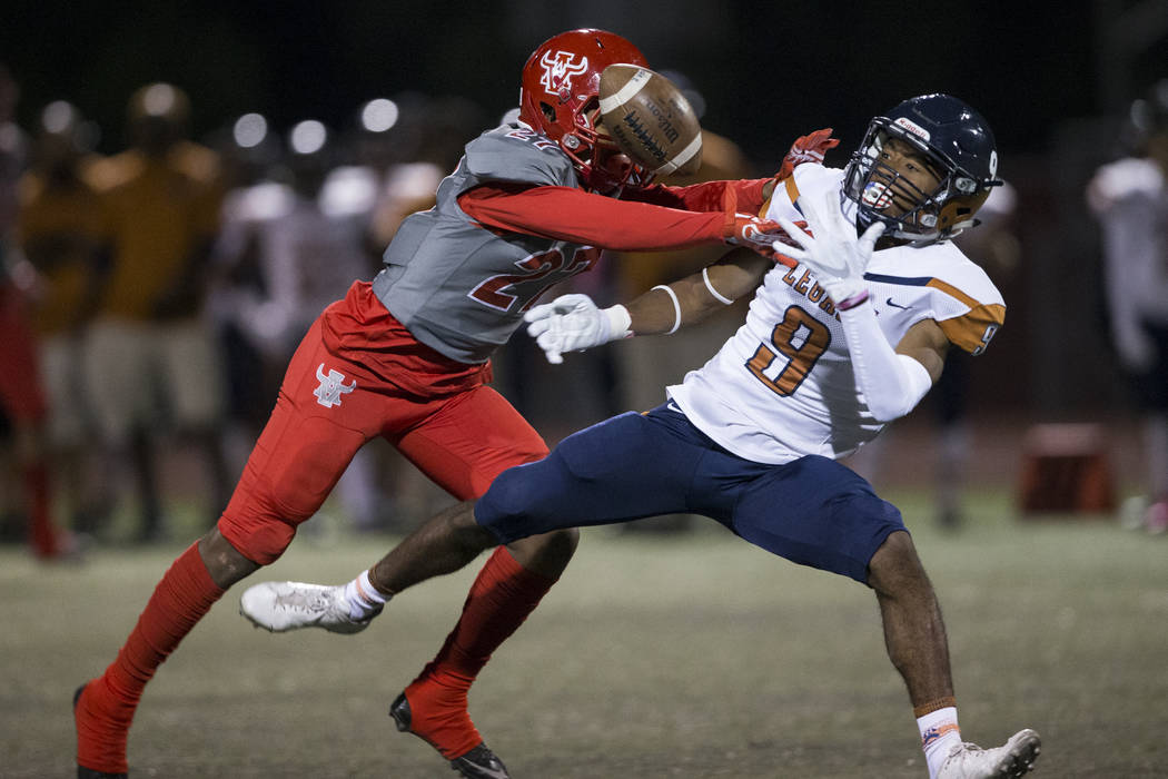 Arbor View's Niles Scafati Boyce (27) breaks up a pass to Legacy's Antoine Clipper jr. (9) in the football game at Arbor View High School in Las Vegas, Friday, Oct. 13, 2017. Erik Verduzco Las Ve ...