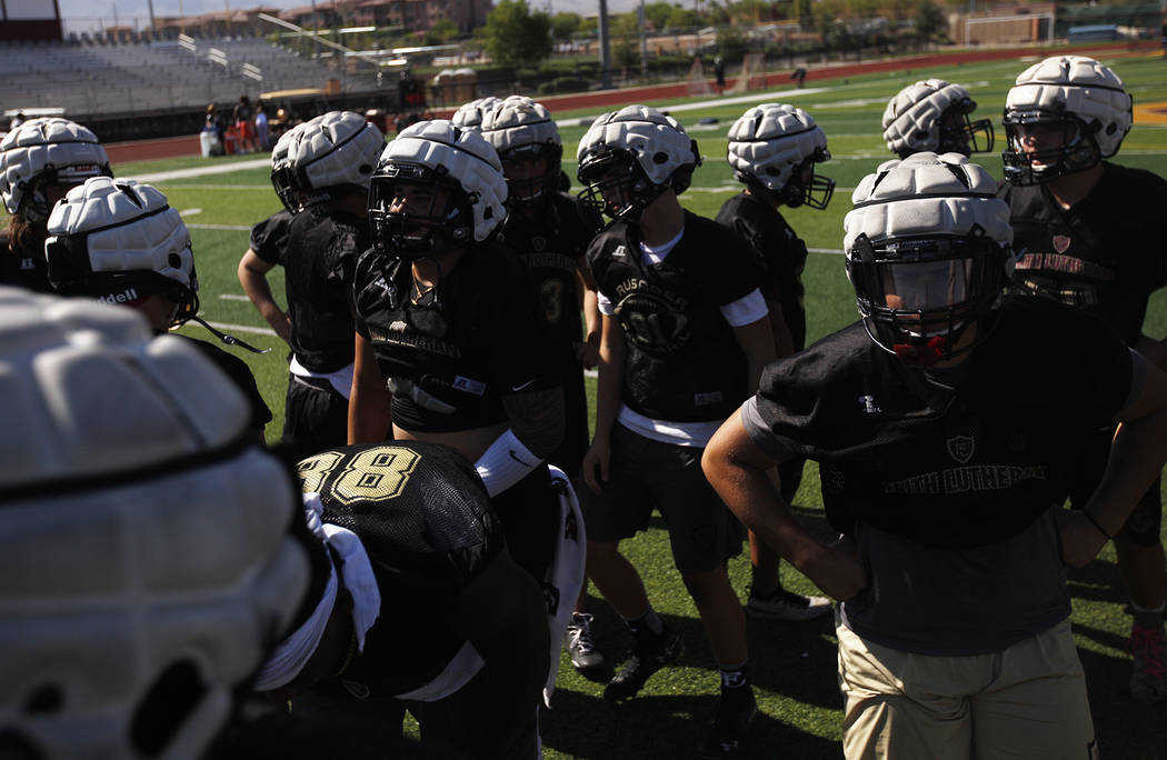 The Faith Lutheran football team rests momentarily during practice at Faith Lutheran High School in Las Vegas, Monday, Aug. 6, 2018. Rachel Aston Las Vegas Review-Journal @rookie__rae
