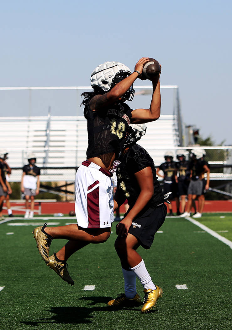 Taimani McKenzie (10) catches the ball during a drill at Faith Lutheran football team practice at Faith Lutheran High School in Las Vegas, Monday, Aug. 6, 2018. Rachel Aston Las Vegas Review-Journ ...