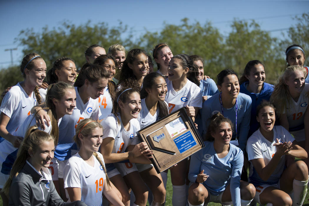 Bishop Gorman players celebrate their victory against Arbor View in the Sunset Region girl's soccer championship game at the Bettye Wilson Soccer Complex in Las Vegas, Saturday, Nov. 4, 2017. Bish ...