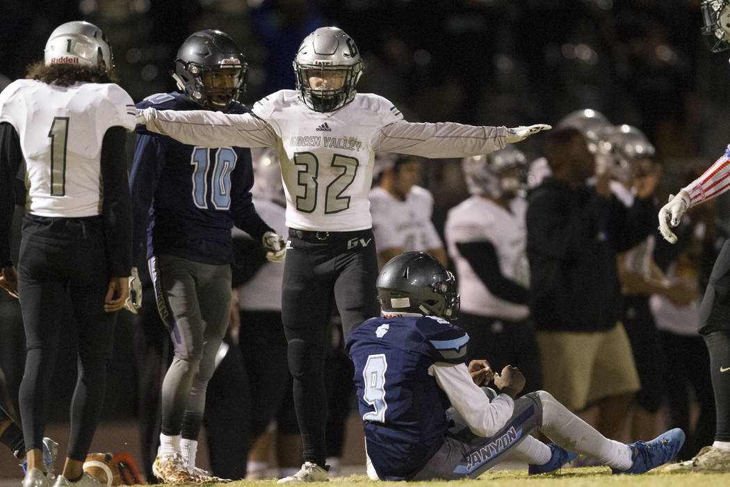 Green Valley's Braxton Harms (32) reacts to the last play of the game against Canyon Springs in the playoff football game at Canyon Springs High School in Las Vegas, Thursday, Nov. 9, 2017. Green ...
