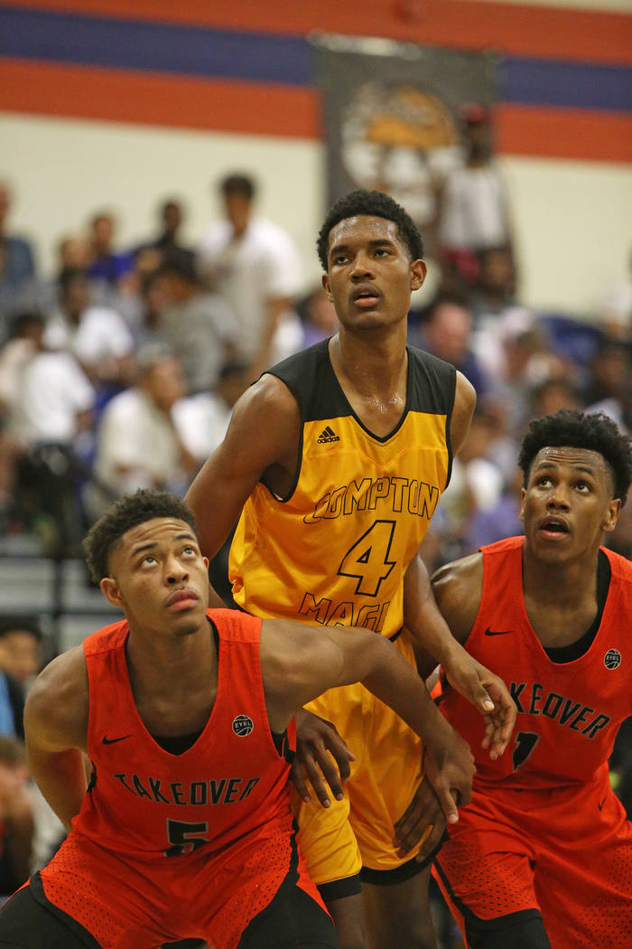Compton Magic's Evan Mobley (4) watches a free throw next to Bishop Gorman's Jamal Bey (5) and Will McClendon (1) at Bishop Gorman High School in Las Vegas, Wednesday, July 25, 2018. Rachel Aston ...