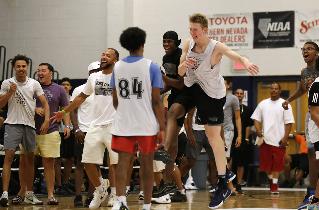 California Stars' players celebrate their victory against Mac Irvin Fire after the Las Vegas Classic platinum premier championship game at Spring Valley High School in Las Vegas, Sunday, July 29, ...