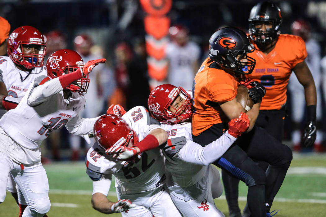 Arbor View's J.J. Tuinei (35) tackles Bishop Gorman's Amod Cianelli (28) during a run in the first quarter of the Class 4A Sunset Region Title football game at Bishop Gorman High School in Las Veg ...
