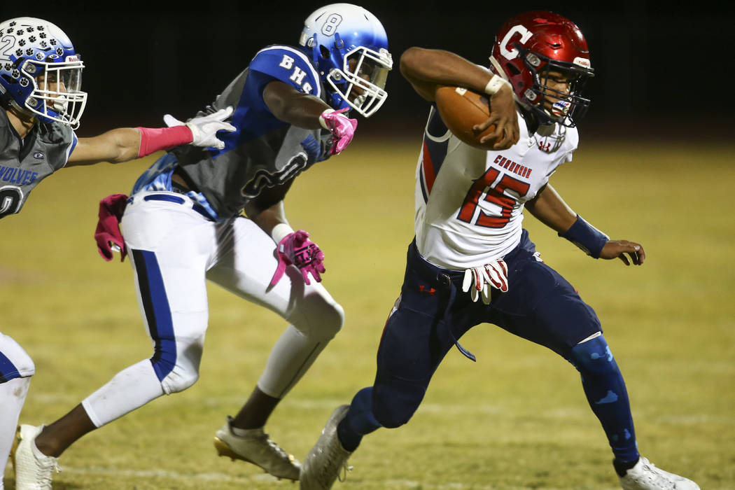 Coronado's Ayzayah Hartfield (15) runs the ball past Basic's Leonard Goodwin (8) during a football game at Basic High School in Henderson on Friday, Oct. 6, 2017. Basic won 45-22. Chase Stevens La ...