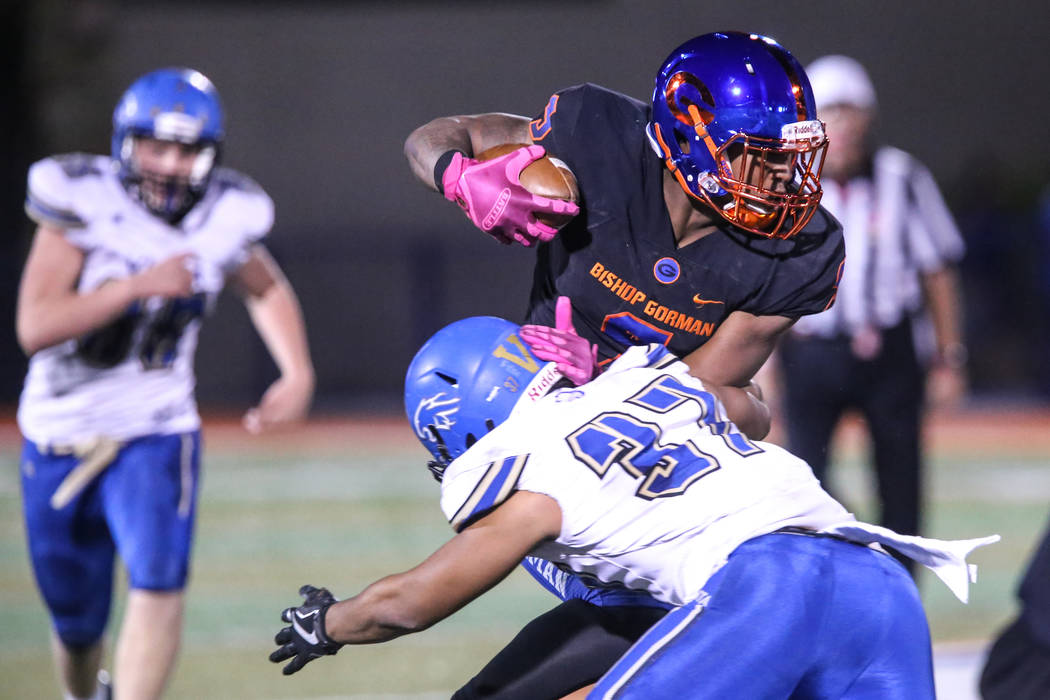 Bishop Gorman's Brevin Jordan (9), top, is tackled by Sierra Vista's Jahsiaah Maiava (37), bottom, during the third quarter of a football game at Bishop Gorman High School in Las Vegas, Thursday, ...