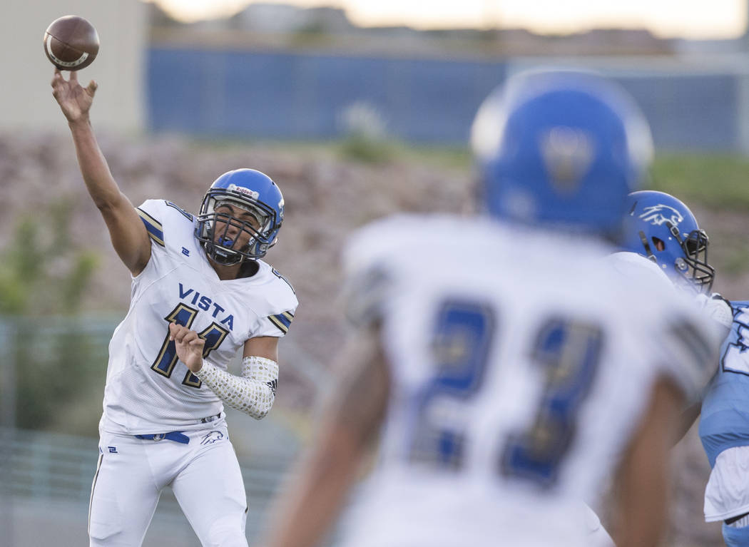 Sierra Vista senior quarterback Jordan Solomon (11) attempts a pass to senior wide receiver Aaron Kahakeauki (23) in the first quarter during the Mountain Lions road matchup with Centennial High S ...