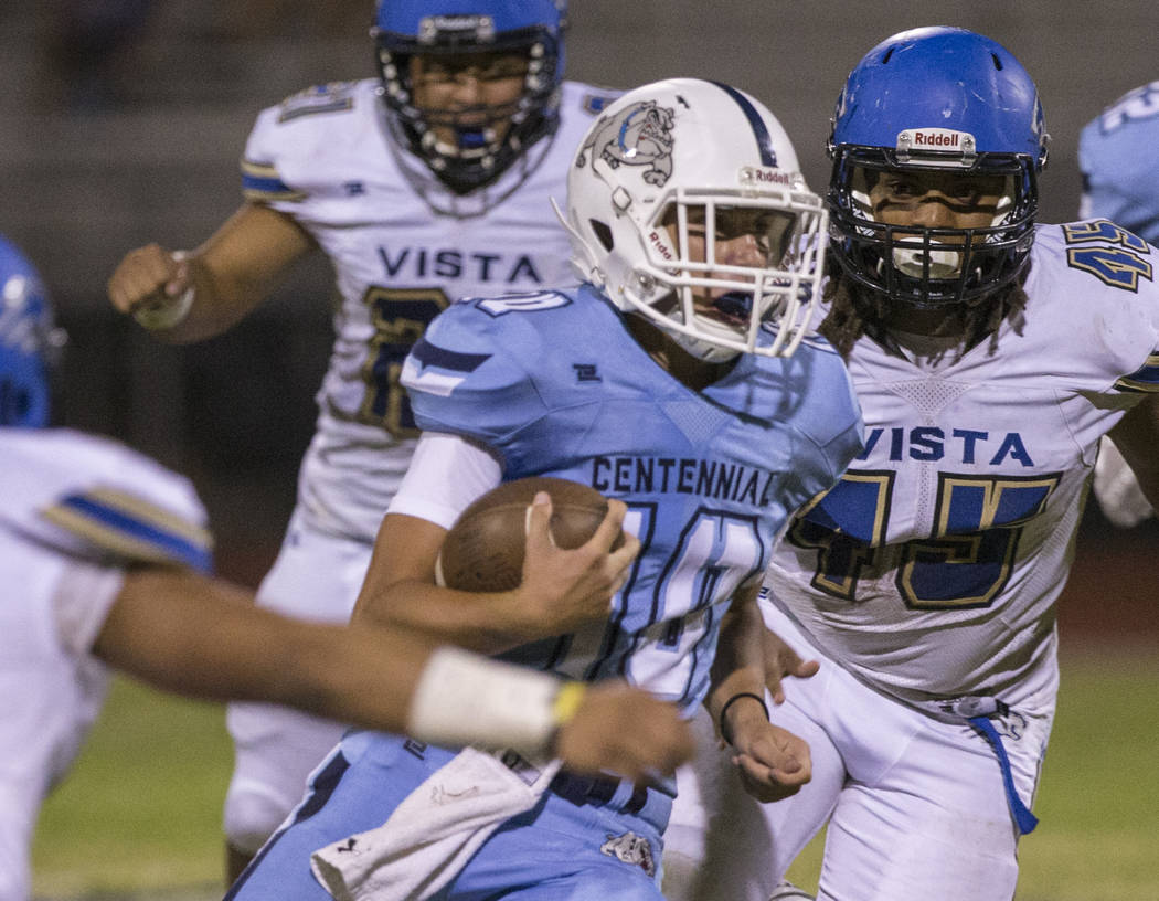 Centennial sophomore quarterback Colton Tenney (10) runs for big yardage past Sierra Vista senior linebacker Demar Ramsey (45) in the second quarter on Friday, Aug. 17, 2018, at Centennial High Sc ...