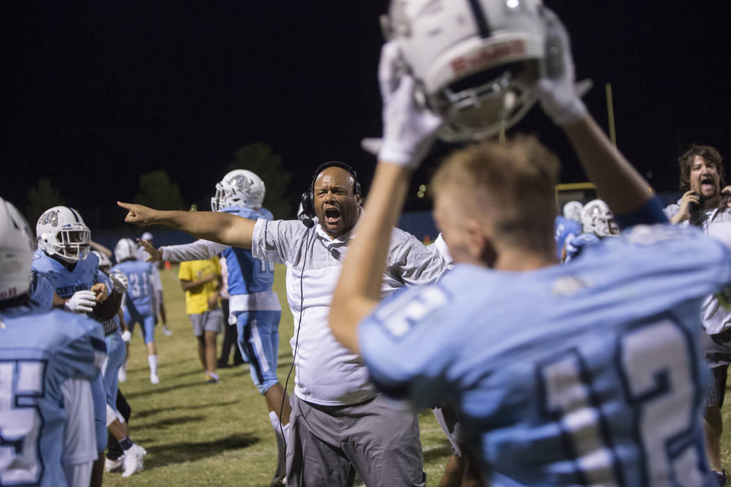 Centennial coach Stan Standifer shouts out instructions to his team in the fourth quarter quarter during the Bulldogs home game with Sierra Vista High School on Friday, Aug. 17, 2018, at Centennia ...