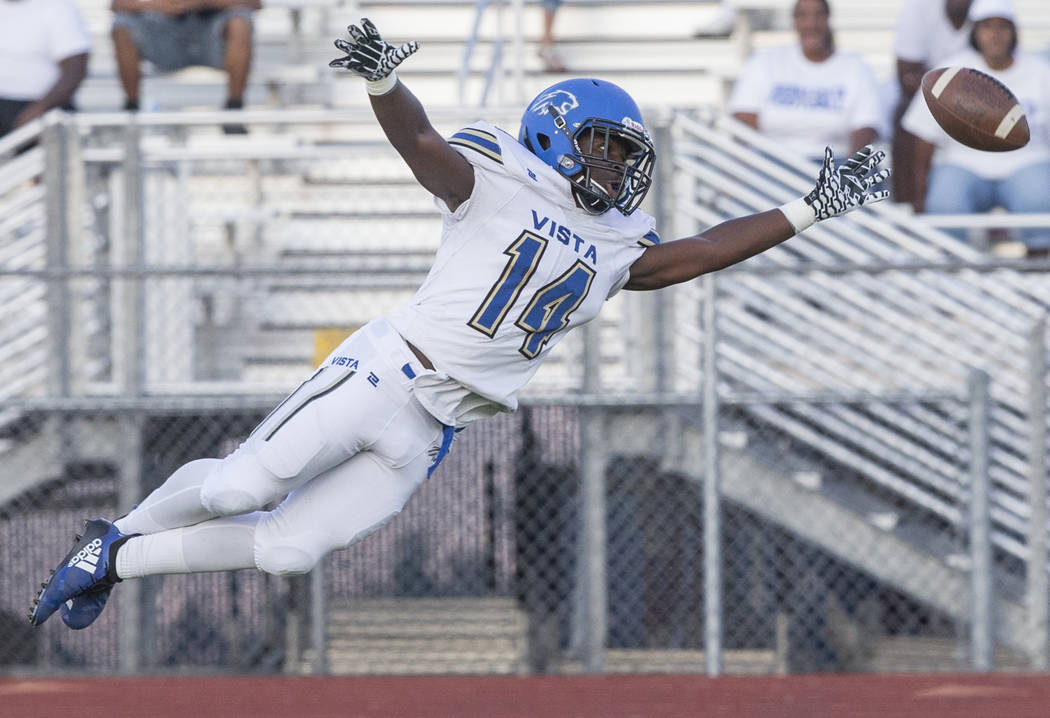 Sierra Vista freshman wide receiver D'Andre Washington (14) lays out to try and make a catch in the first quarter during the Mountain Lions road matchup with Centennial High School on Friday, Aug. ...