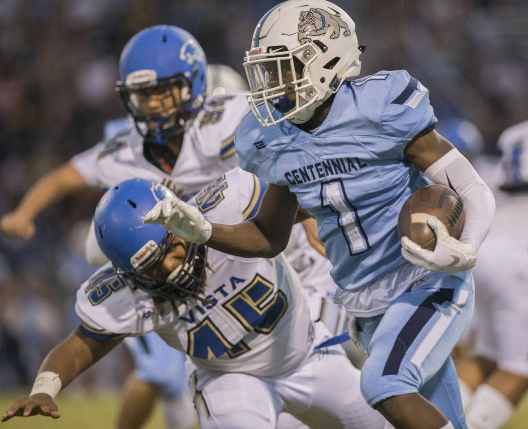 Centennial junior running back Jordan Smith (1) breaks a big run past Sierra Vista senior linebacker Demar Ramsey (45) in the first quarter on Friday, Aug. 17, 2018, at Centennial High School, in ...