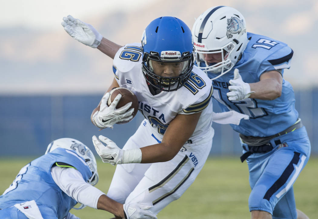 Sierra Vista senior wide receiver Tristen Jimenez (16) runs down the sideline past Centennial senior defensive back Tyler Hermanson (12) in the first quarter on Friday, Aug. 17, 2018, at Centennia ...