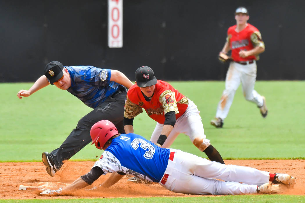 Midland, Mich., Berryhill Post 165's Tyler David dives for second during game seven of The American Legion World Series at Veterans Field at Keeter Stadium in Shelby, N.C., on Saturday, Aug. ...