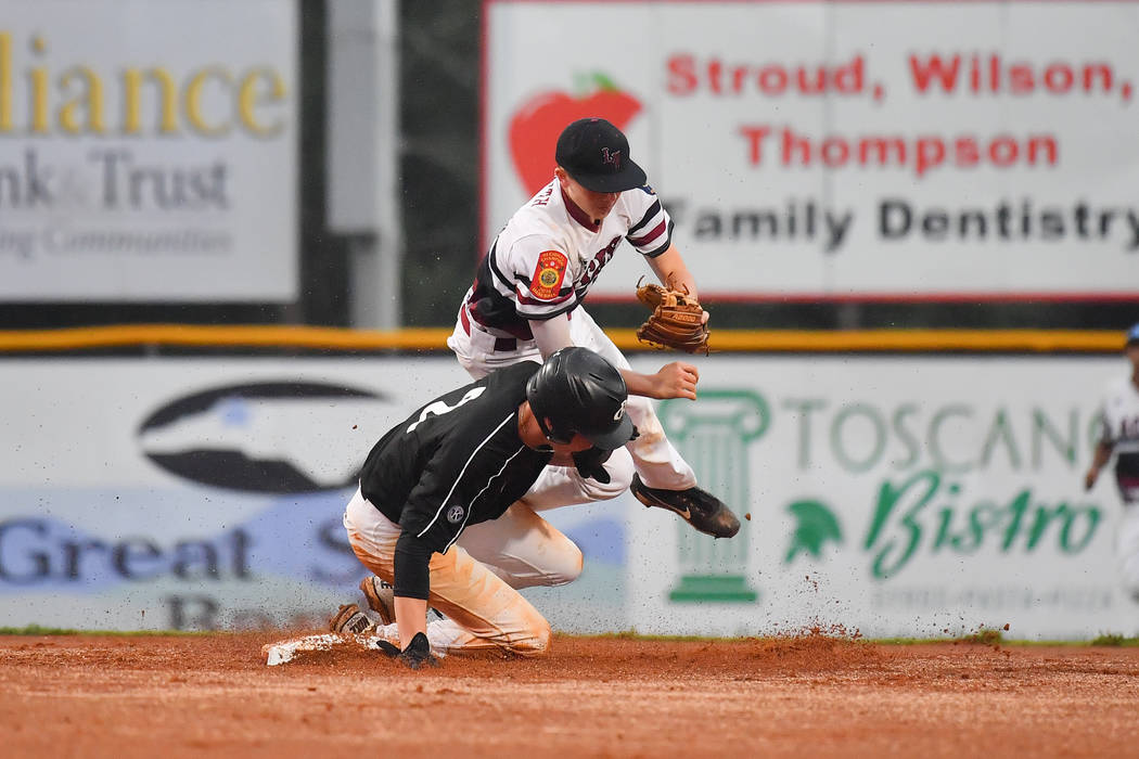 Dawson Painter of Asheboro, N.C., Randolph County Post 45 (black jersey,) collides with Las Vegas, Nev., Post 40's Colby Smith at second amidst a successful double play at Veterans Field at Keete ...