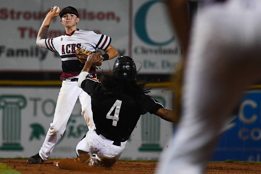 Colby Smith of Las Vegas, Nev., Post 40 throws over Asheboro, N.C., Randolph County Post 45's Trevor Marsh to complete a double play in the bottom of the second inning at Veterans Field at Keete ...