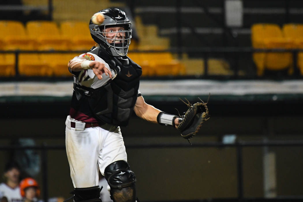 Las Vegas, Nev., Post 40's Parker Schmidt scoops a bunted ball and picks up the out at the top of the third inning at Veterans Field at Keeter Stadium in Shelby, N.C., on Sunday, Aug. 19, 2018 du ...