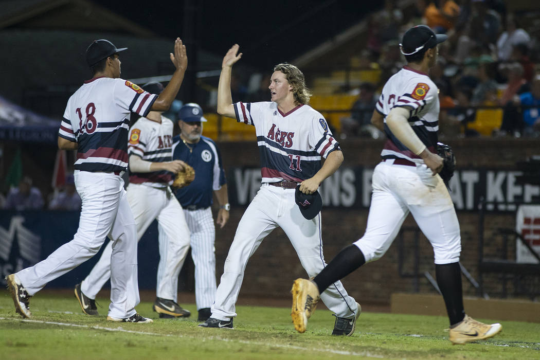 Josh Sharman congratulates Jimmy Gamboa of Desert Oasis in game 14 of The American Legion World Series at Veterans Field at Keeter Stadium in Shelby, N.C., on Monday, Aug. 20, 2018. Photo by Chet ...