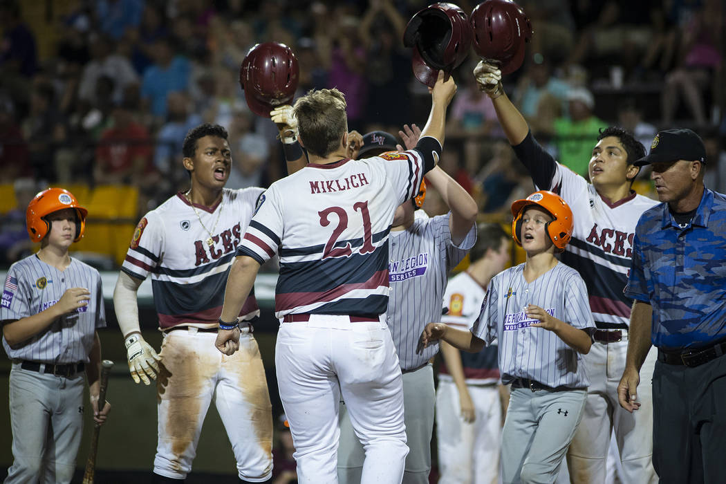 Chaison Miklich of Desert Oasis is congratulated after a home run in game 14 of The American Legion World Series at Veterans Field at Keeter Stadium in Shelby, N.C., on Monday, Aug. 20, 2018. Pho ...