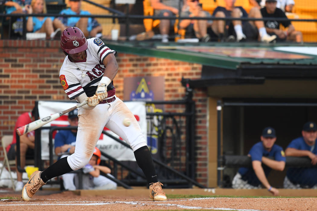 Edarian Williams takes a swing during the the 2018 American Legion World Series championship game at Veterans Field at Keeter Stadium in Shelby, N.C., on Tuesday, Aug. 21, 2018 during game 12 of t ...