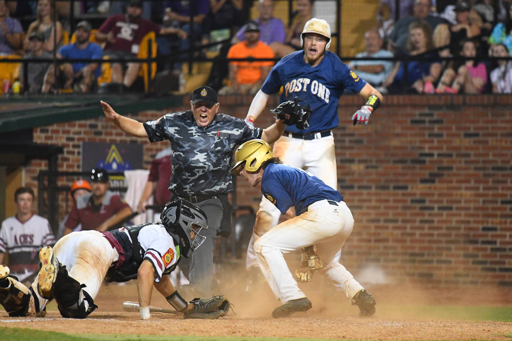 Wilmington's Michael Cautillo scores the winning run in the eighth inning at Veterans Field at Keeter Stadium in Shelby, N.C., on Tuesday, Aug. 21, 2018 during game 12 of the 2018 American Legion ...