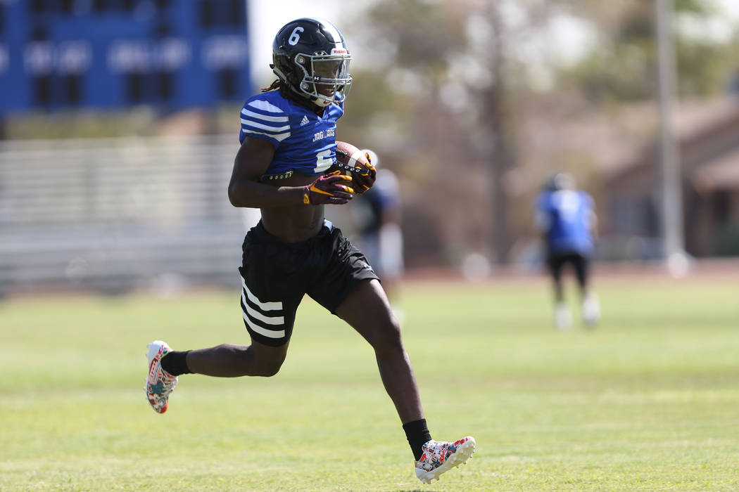 Desert Pines senior running back Cameron Wiley runs the ball during a team practice at Desert Pines High School in Las Vegas, Tuesday, Aug. 28, 2018. Erik Verduzco Las Vegas Review-Journal @Erik_V ...
