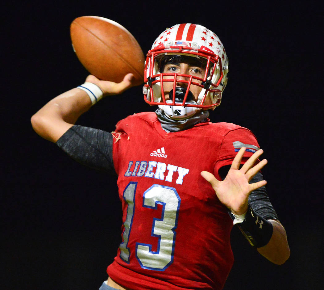 Liberty quarterback Isaac Haina (13) throws a pass during a game against IMG Academy at Liberty High School in Henderson on Friday, Sept. 7, 2018. IMG Academy leads at halftime 21-0. Brett Le Blan ...