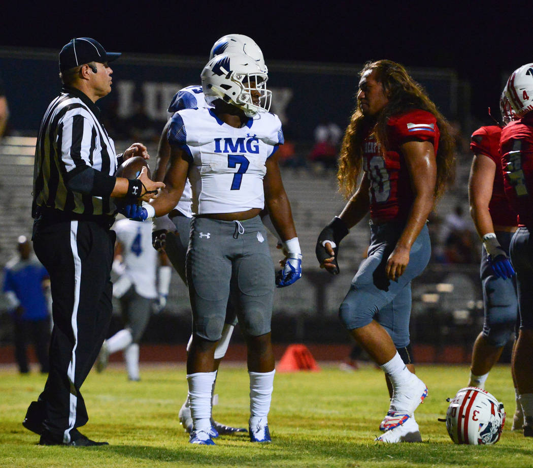 Liberty's Zyrus Fiaseu (30) stares down IMG Academy's running back Noah Cain (7) after Cain scored a touchdown at Liberty High School in Henderson on Friday, Sept. 7, 2018. IMG Academy leads at ha ...