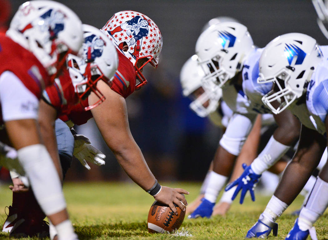 Liberty center Jeremiah Taiese (75) gets ready to snap the ball during a game against IMG Academy at Liberty High School in Henderson on Friday, Sept. 7, 2018. IMG Academy won 35-0. Brett Le Blanc ...