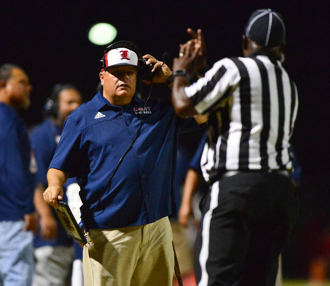 Liberty head coach Rich Muraco talks to a referee at Liberty High School in Henderson on Friday, Sept. 7, 2018. IMG Academy won 35-0. Brett Le Blanc Las Vegas Review-Journal