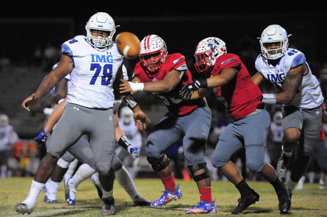 IMG Academy's Antoine Whitner Jr. (78), Liberty's A.J. Maluia (58), Ezra Thomhoon (5) and IMG Academy's Nolan Smith (42) watch a Liberty fumble that was returned for an IMG touchdown at Liberty H ...