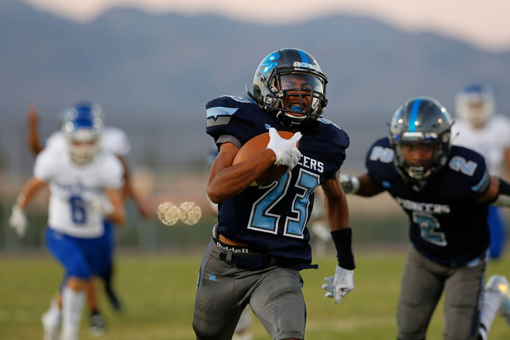 Canyon Springs' Trayvion Rainey (23) scores a touchdown against Green Valley High School in the first half of a football game at Canyon Springs High School in North Las Vegas, Friday, Sept. 7, 201 ...