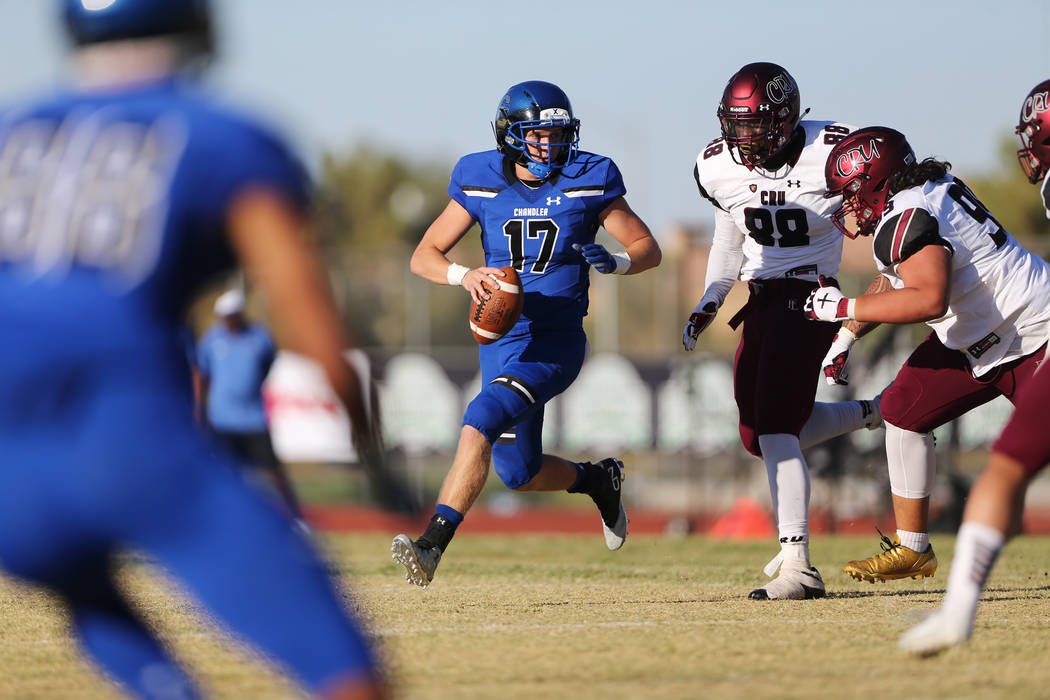 Chandler's Jacob Conover (17) looks for an open pass under pressure from Faith Lutheran's David Heckard (88) in a football game at Liberty High School in Henderson, Saturday, Sept. 8, 2018. Erik V ...