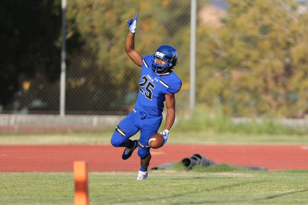 Chandler's Decarlos Brooks (25) celebrates his touchdown run against Faith Lutheran in the first quarter of a football game at Liberty High School in Henderson, Saturday, Sept. 8, 2018. Erik Verdu ...