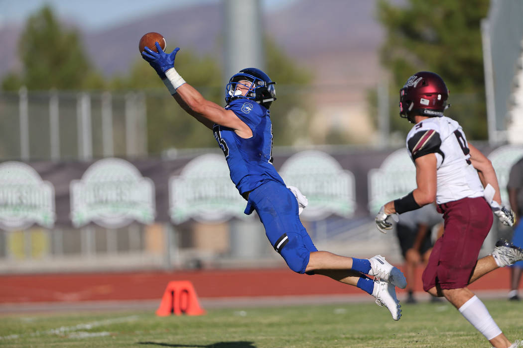 Chandler's Gunner Maldanado (13) makes a diving catch against Faith Lutheran in the first quarter of a football game at Liberty High School in Henderson, Saturday, Sept. 8, 2018. Erik Verduzco Las ...