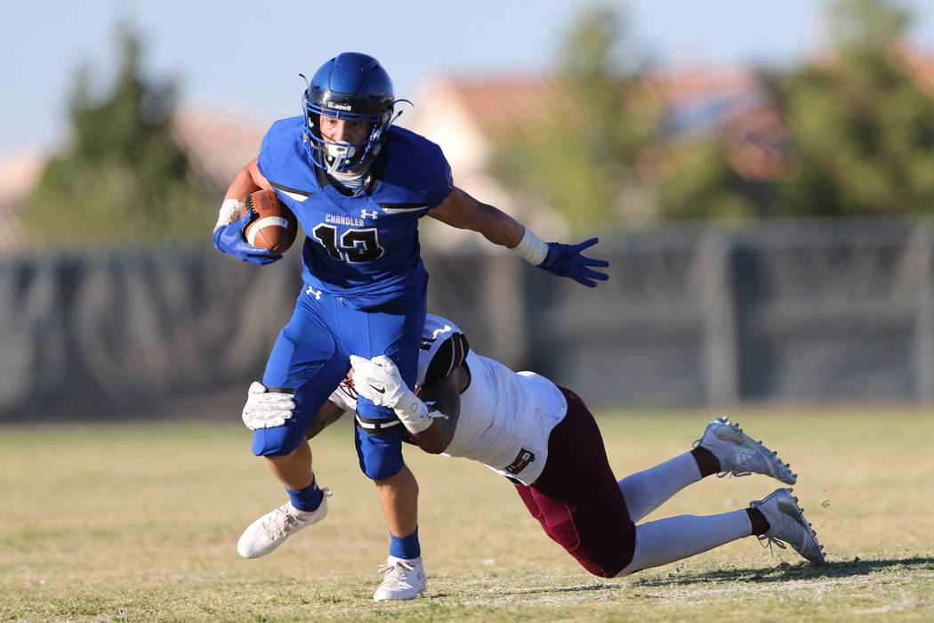 Chandler's Gunner Maldanado (13) is tackled for no gain against Faith Lutheran's Ma'a Gaoteote (11) in the first quarter of a football game at Liberty High School in Henderson, Saturday, Sept. 8, ...