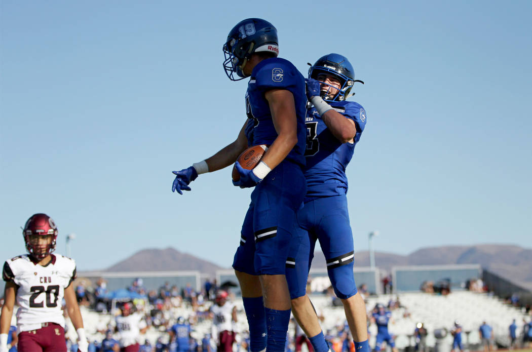 Chandler's Brayden Liebrock (19), left, celebrates his touchdown with Gunner Maldanado (13) against Faith Lutheran in the first quarter of a football game at Liberty High School in Henderson, Satu ...