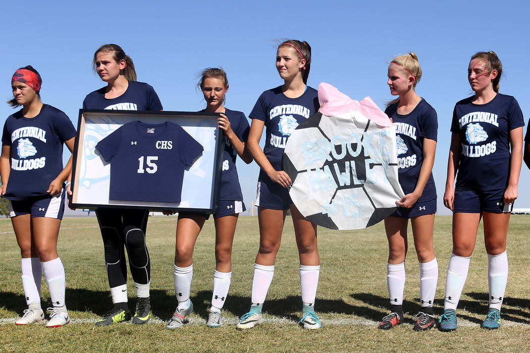 Members of Centennial High School's women's soccer team wear Brooke Hawley's number 15 jersey during a ceremony before a game against Palo Verde High school at Centennial High School in Las Vegas, ...