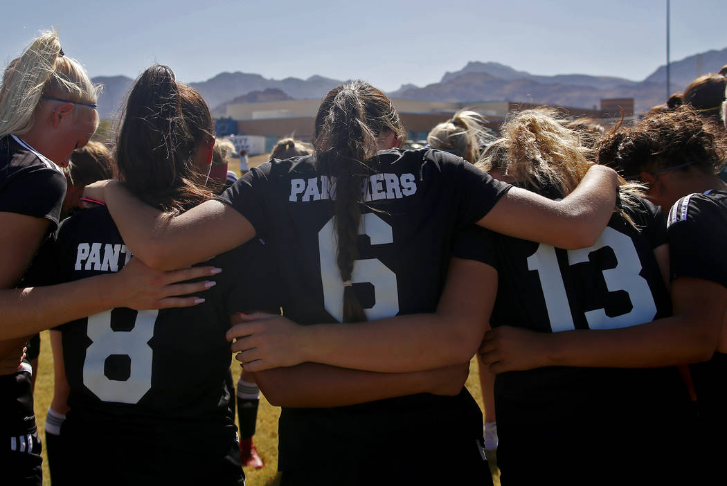 Palo Verde High School's Holly Lindholm (6) huddles with her team before a game at Centennial High School in Las Vegas, Wednesday, Sept. 12, 2018. Lindholm was best friends with Brooke Hawley, a s ...