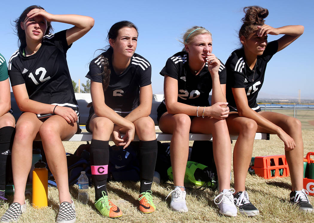 Palo Verde High School's Meghan Harkin (21), from left, Jordan Schnitz (12), Holly Lindholm (6), Carlee Giammona (17), and Kassie Sayles (15) watch their teammates compete in a game at Centennial ...